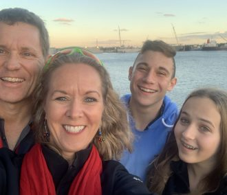 family on cruise at sunset selfie