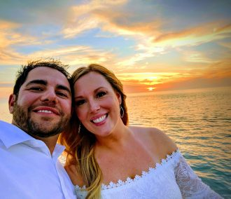 couple on cruise at sunset selfie
