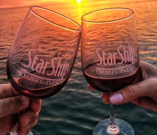 yacht starship wine glasses toasting at sunset