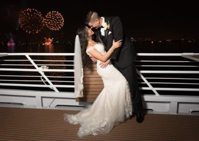 bridge and groom on yacht with fireworks
