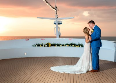 bride and groom on top deck