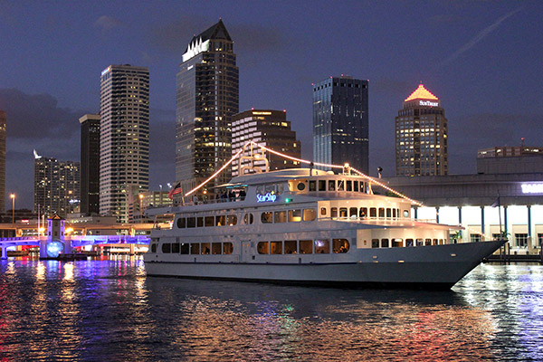 Yacht StarShip cruising Downtown Tampa at night